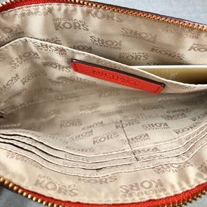 Michael Kors Bags - AUTHENTIC Michael Kors Large Zip Clutch